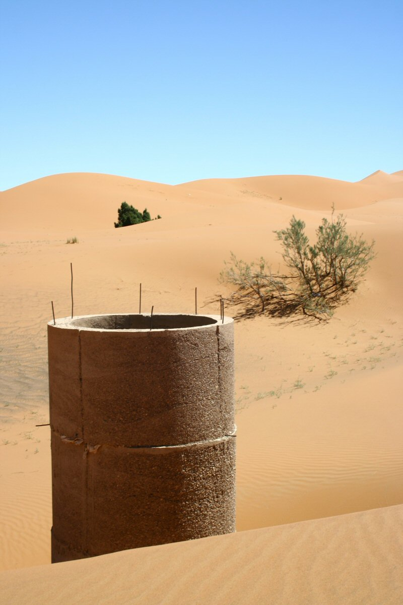 A well in the dunes.