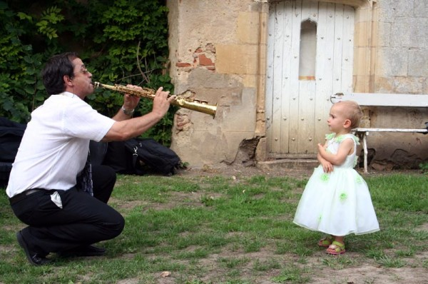 Little girl and musician