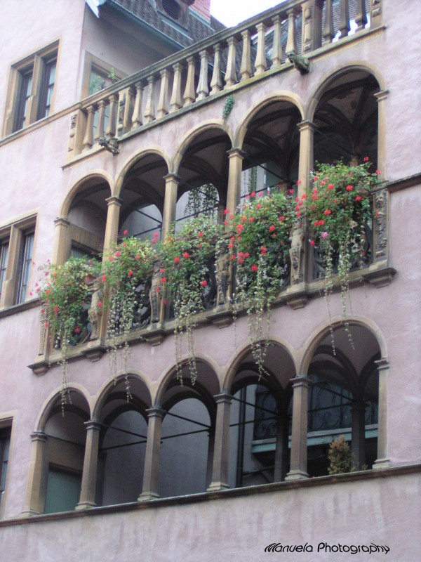 colmar france alsace arch flowers windows