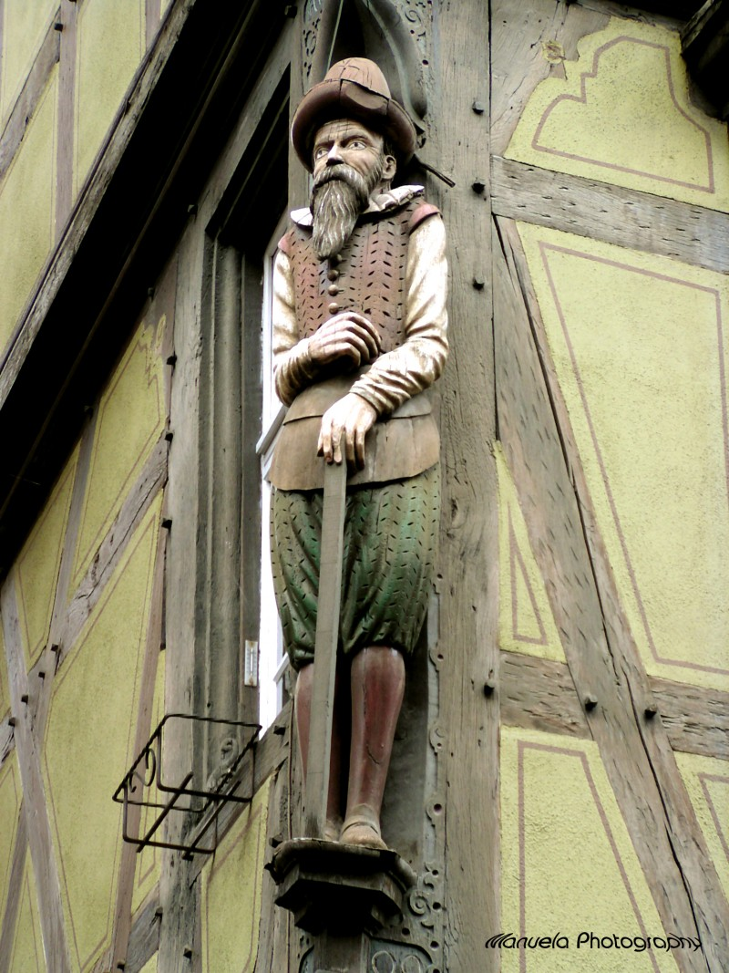 wood statue house fassade colmar france alsace