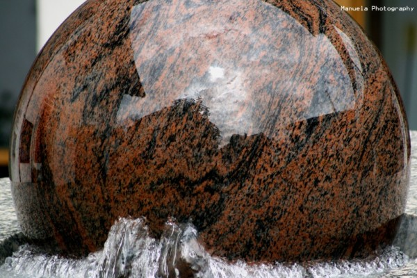 fountain water ball marble reflections mirror