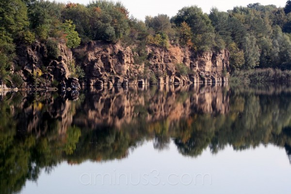 lake water shore reflection stone pit germany