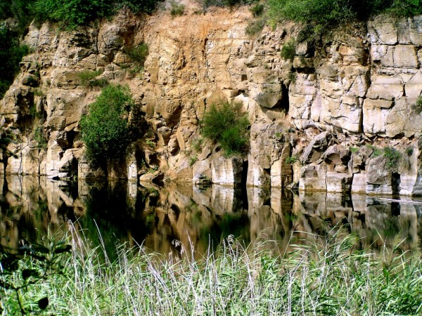 stone water lake shore reflections germany way pit