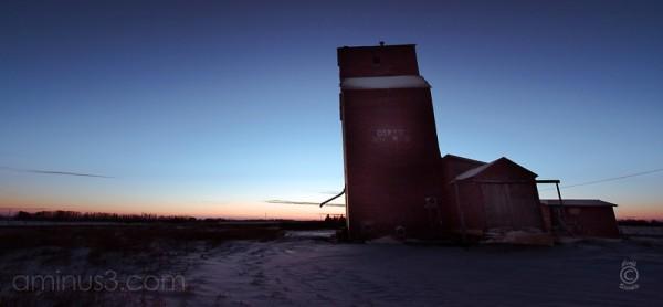 Grain elevator against the sunrise