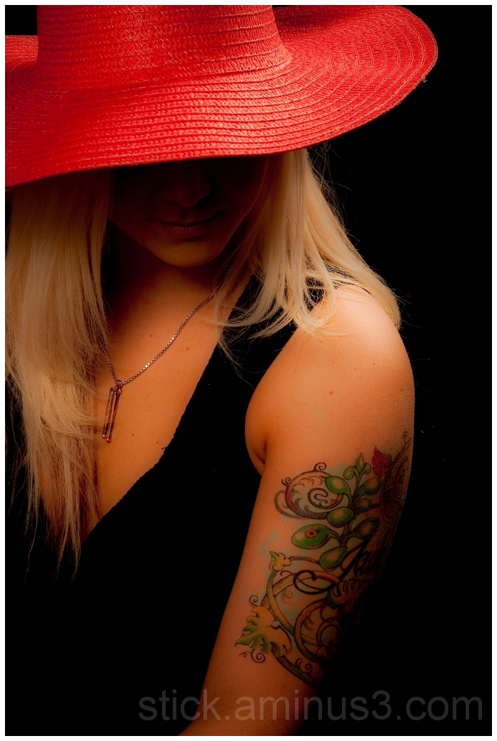 Model wearing a red hat