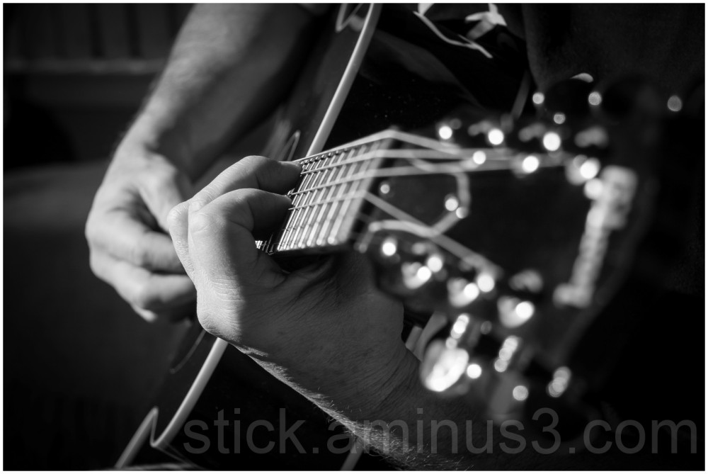 strumming on an acoustic guitar