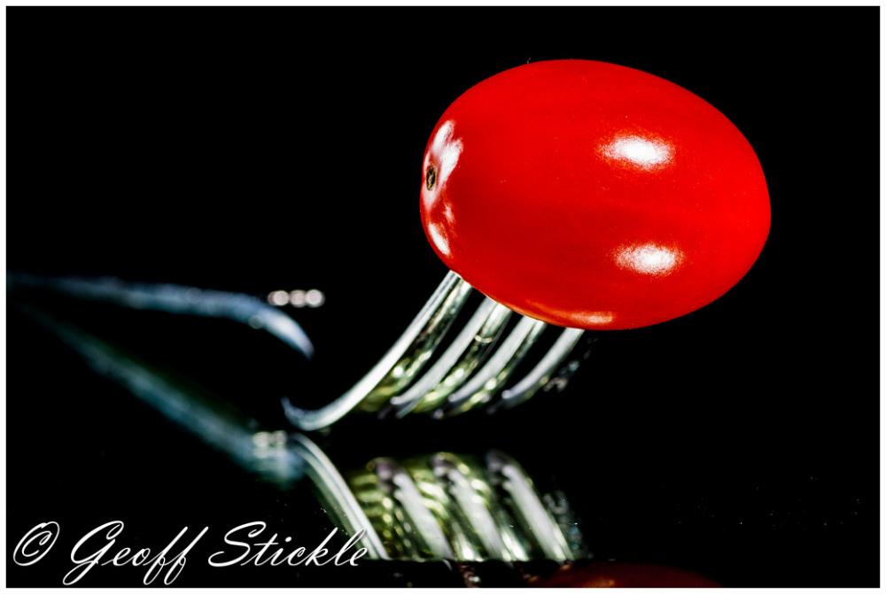Cherry tomato on a fork
