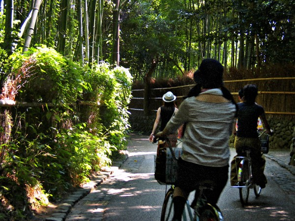 Girls bike in kyoto bamboo forest