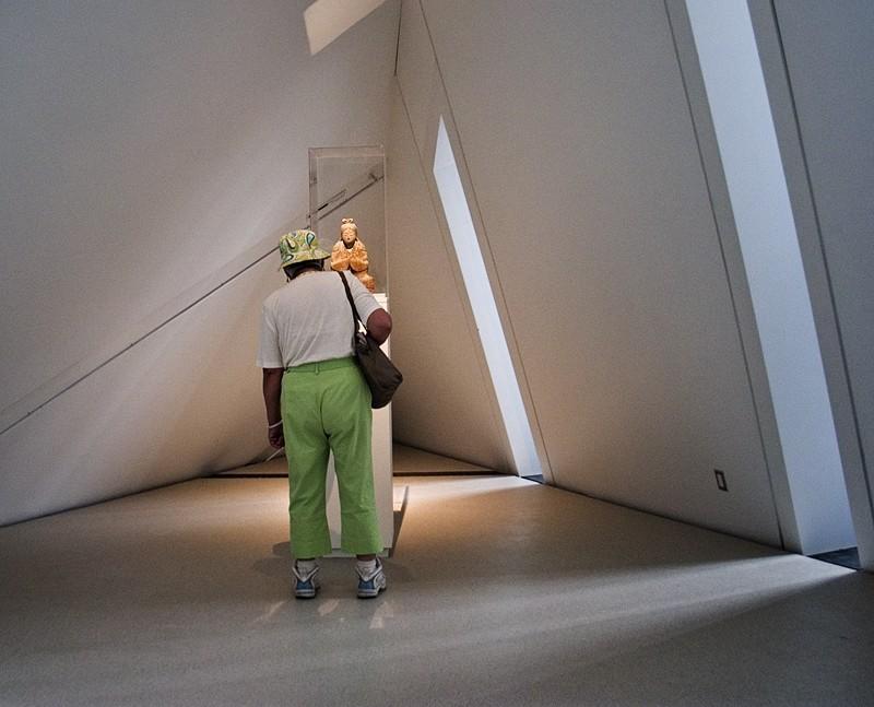 Female Shinto Deity Regards Woman in Green Pants