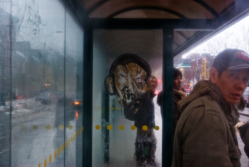 Faces at the streetcar shelter
