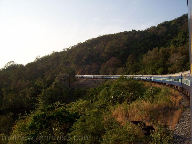 Train going around mountain