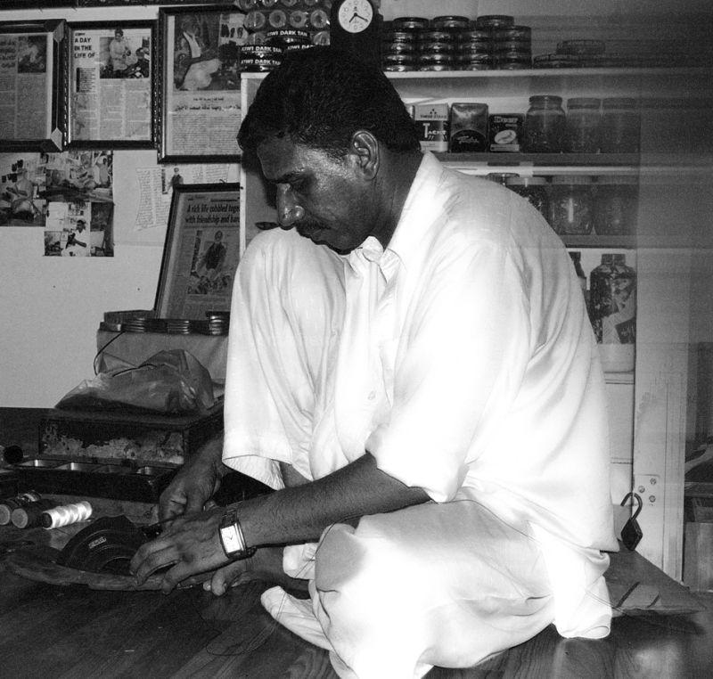 Cobbler working in the bazaaar