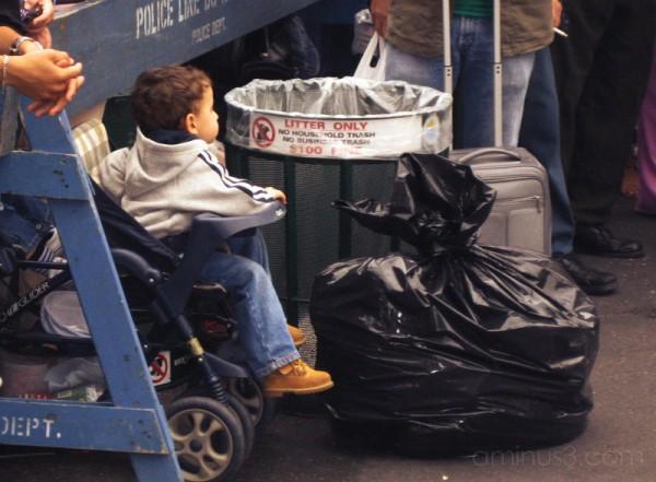 Boy by the Trash