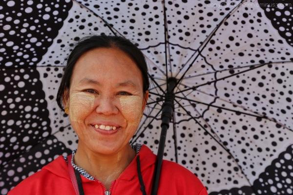 A smile under a parasol