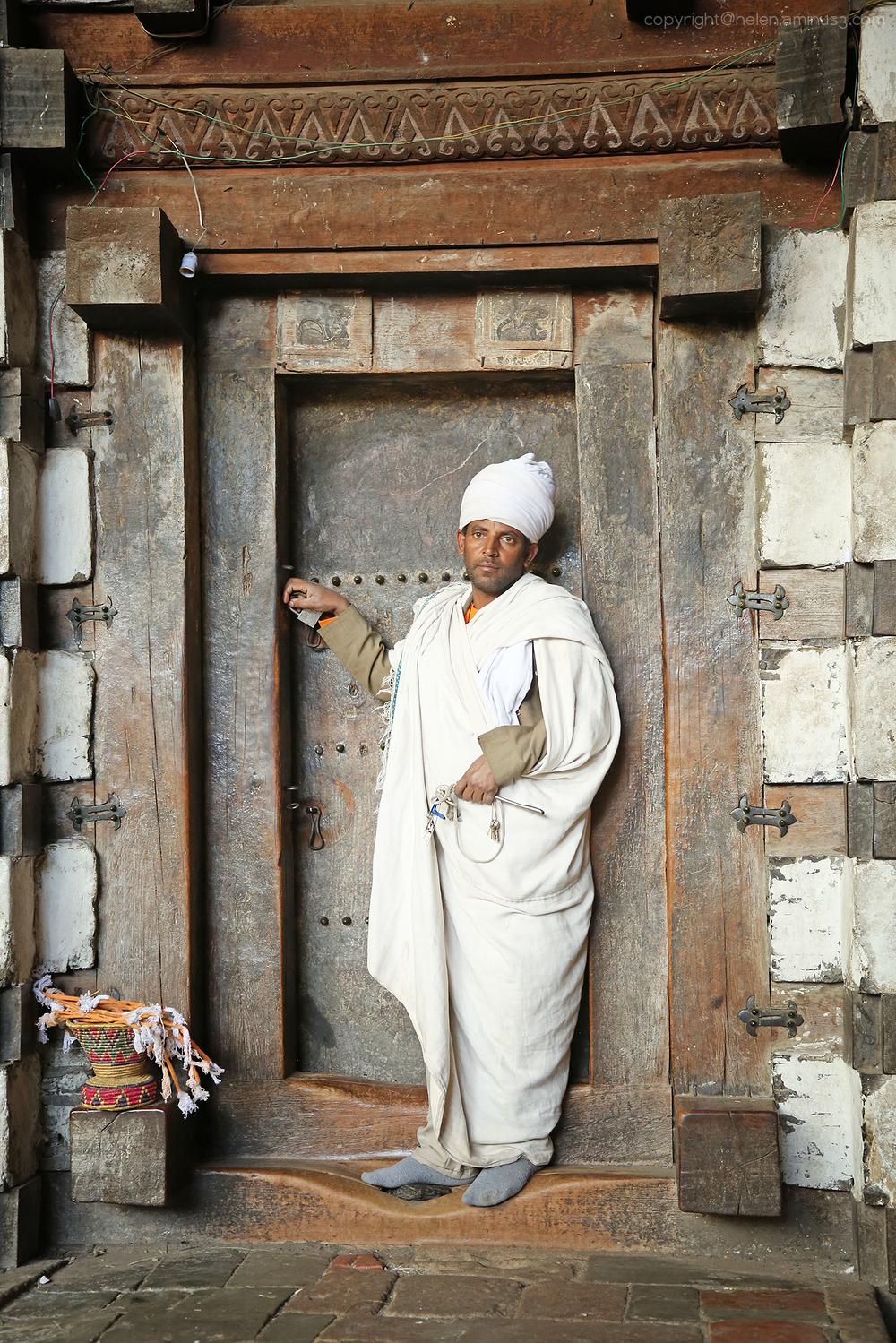 Priest in the doorway