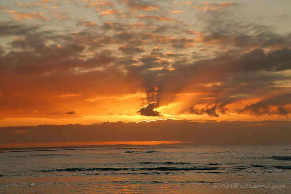 Surfers at dawn