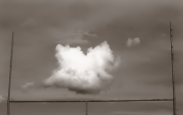 Cloud between goalposts.