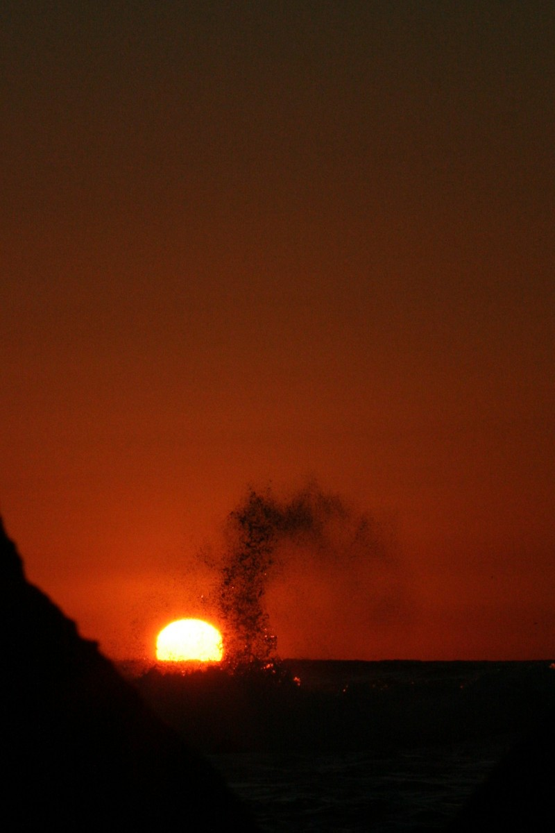 Sunset, Rocks and a Breaking Wave
