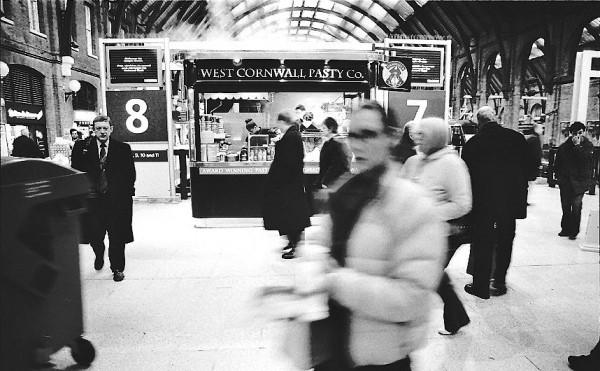 Woman passing, Kings Cross, London