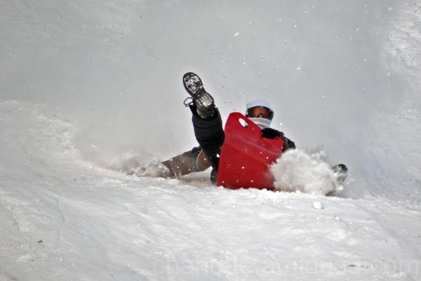 Man on sledge in snow