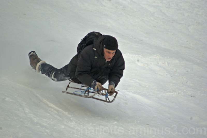 Man on sledge in snow