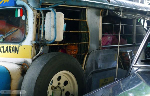 ermita taft ave manila jeep bored kid passenger