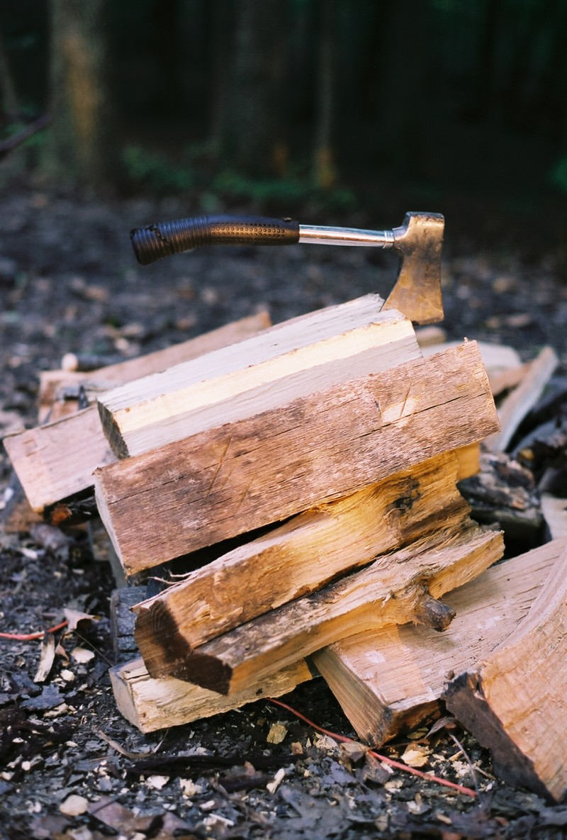 Hatchet on the firewood pile