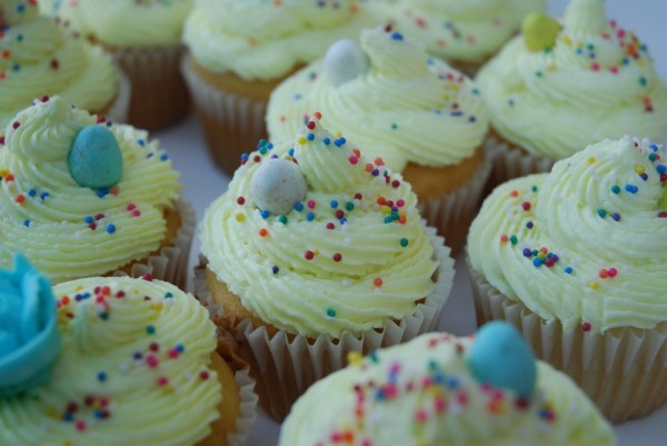 vanilla cupcakes with lemon frosting and sprinkles