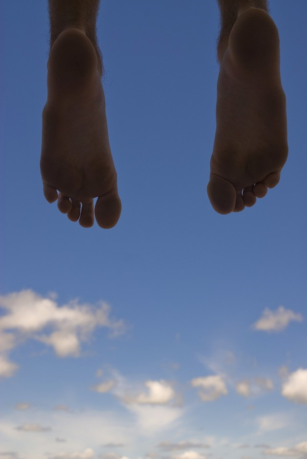 bare feet against the sky