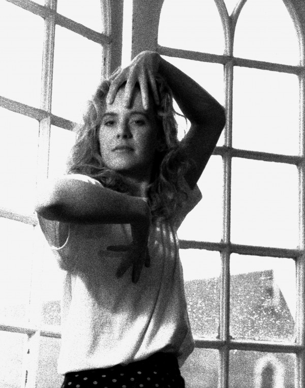 blond, beautiful girl at window