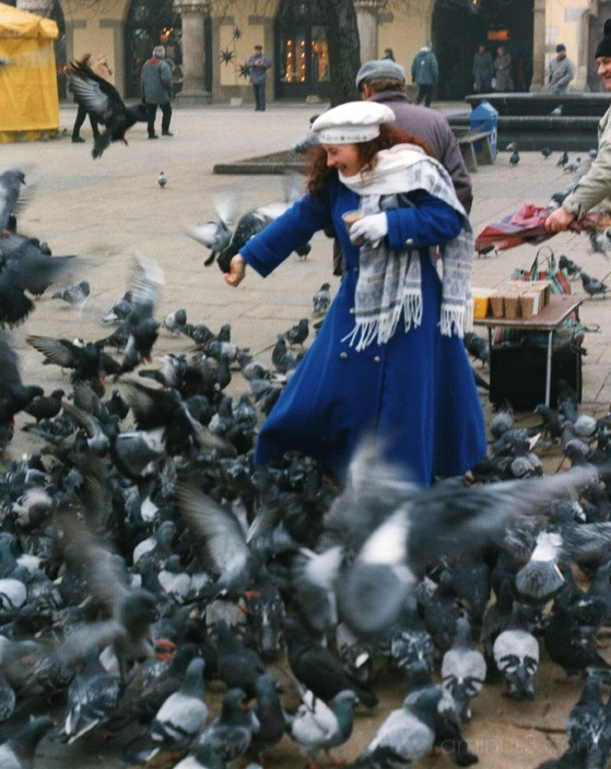 girl with birds in Krakow, Poland