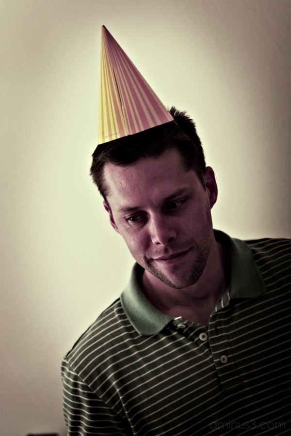 Funny image of a grown man in party hat.