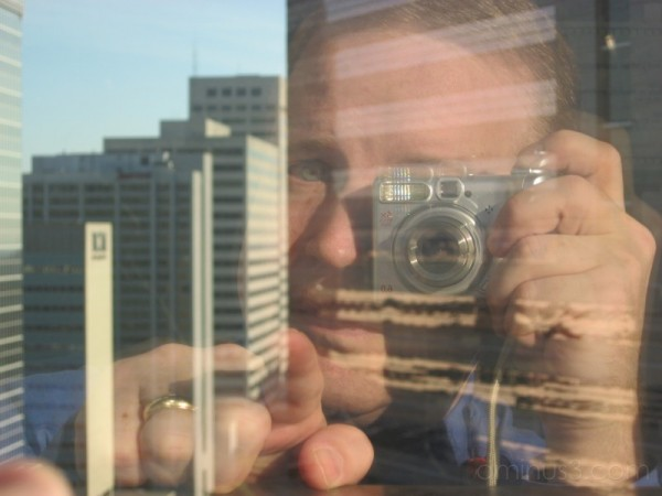 Self portrait - 15 floors up, reflection on glass