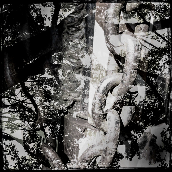 a double exposure of trees and chains