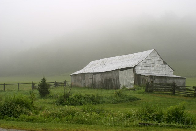A barn in the mist