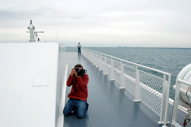 Photographer taking a photo on a boat