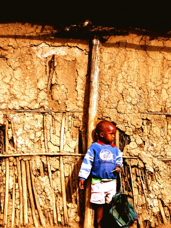 A young Kenyan boy with his bag.