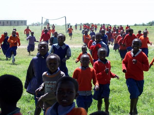 A group of Kenyan children running.