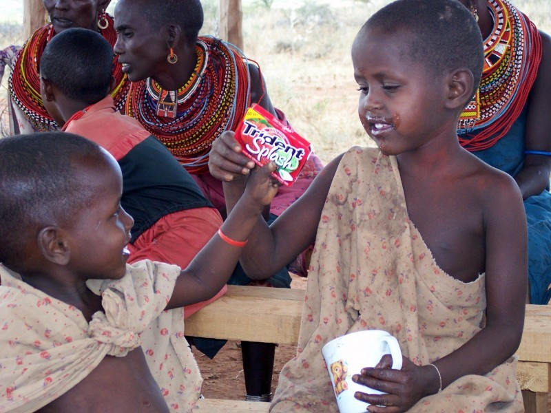 Two young Kenyan boys share a treat.