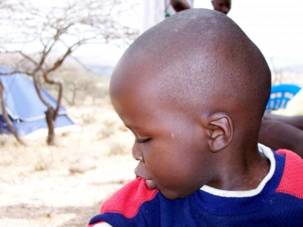 A boy out in Kenya.