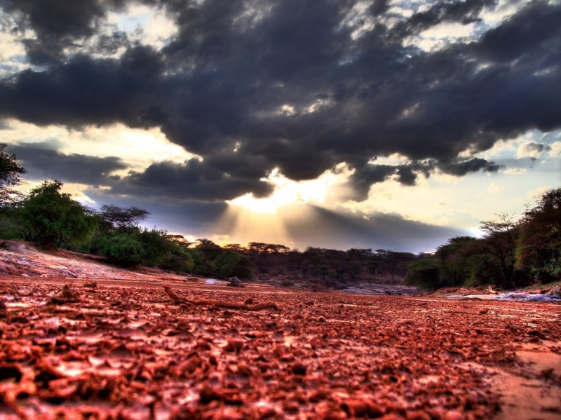 A Kenyan sunset over a dried river bed.