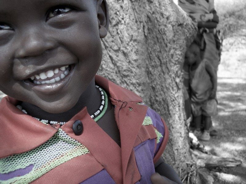 In a rural place in Kenya, a boy smiles.