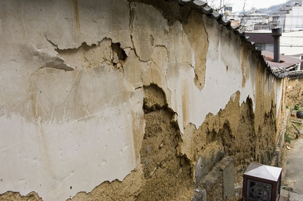 A deteriorating mud wall.