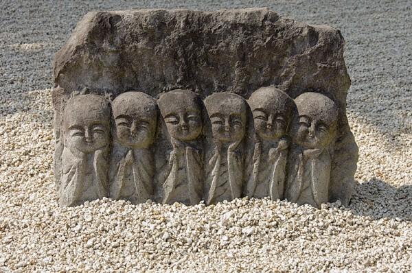 Figures in raked gravel at Shoboji Temple.