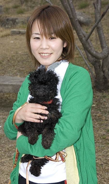 A girl and her dog at Hofu Tenmangu Shrine.