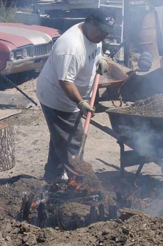 Pottery firing at Santa Clara Pueblo.