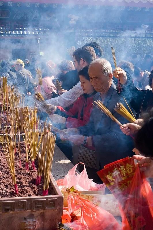 Worshipers at Sik Sik Yuen Temple.