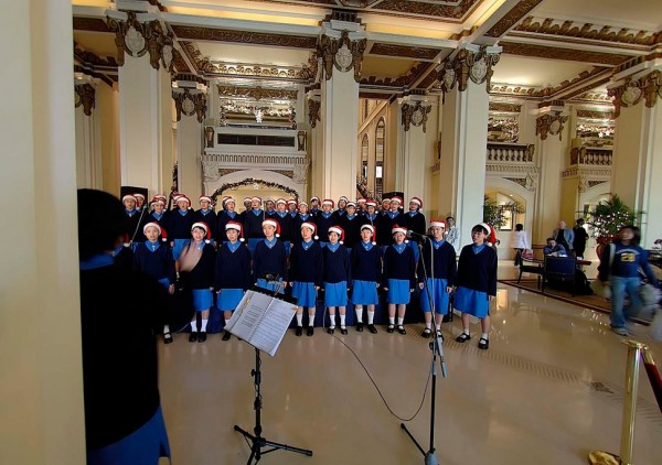 A choir sings at high tea.
