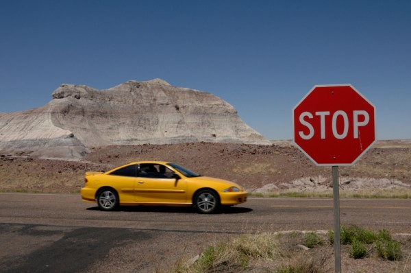 A yellow car in the Petrified Forest NP.