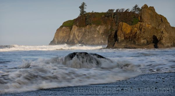 A rock awash in the surf at Ruby Beach.